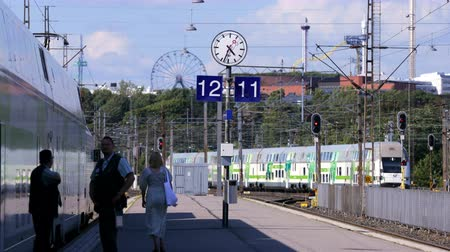 dowel : HELSINKI, FINLAND - JUNE 16, 2016: Passengers and train on the platform of the railway station in Helsinki. Time Lapse.