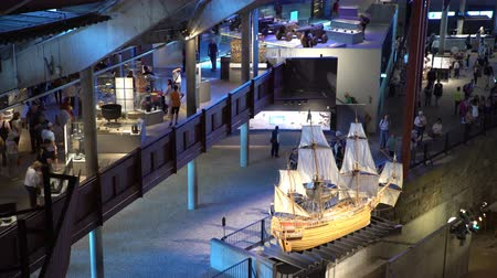 vasa : STOCKHOLM, SWEDEN - MAY 31, 2016: Many visitors to the interior of the Maritime Vasa Museum in Stockholm. Stock Footage