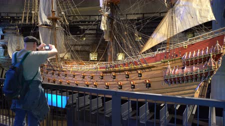vasa : STOCKHOLM, SWEDEN - MAY 31, 2016: Lots of tourists to the interior of the Maritime Vasa Museum in Stockholm. Time Lapse.