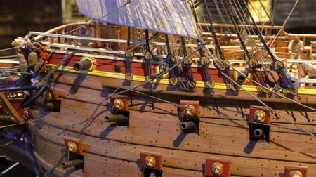 vasa : STOCKHOLM, SWEDEN - MAY 01, 2016: Model of wooden fighting ship of the 17th century against the backdrop of the reconstructed ship Vasa in the same museum. Dolly shot. Stock Footage