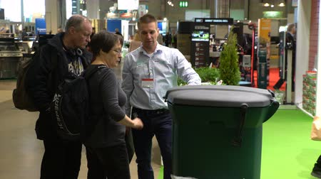 septic : HELSINKI, FINLAND - APRIL 07, 2017: Consultant in the store demonstrates new high-tech container for sorting and disposing of garbage. Annual Fairs Own Cabin, Own, Home at the Expocenter of Messukeskus. Stock Footage