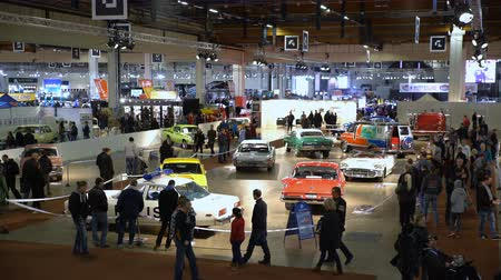 auto show : HELSINKI, FINLAND - APRIL 16, 2017: A lot of gorgeous vintage old cars at the auto show. The 40th American Car Show in Helsinki Fair Center Stock Footage