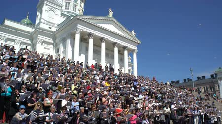 marş : HELSINKI, FINLAND - MAY 19, 2017: Huge choir singing on the steps of the Cathedral. Rehearsal for the big choir at the Senate square on the eve of the church music festival Sana soi Stadissa .
