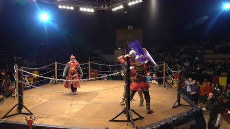 reencenação : MOSCOW, RUSSIA - APR 12, 2016: Two Medieval Knight Fighting In An Arena With Swords And Shields. Great Knights tournament Valor and Honor . Stock Footage