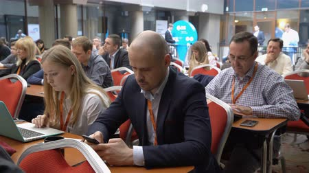 counsel : MOSCOW, RUSSIA - APRIL 28, 2016: Conference participants listen to the speaker. Conference on mobile technologies and innovation for health M-Health Congress .