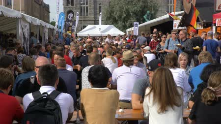 renowned : HELSINKI, FINLAND - JULY 29, 2017: A lot of people drink beer and eat outdoors. Beer Fair in the Railway Square in Helsinki