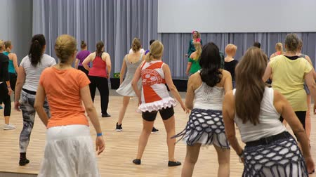 all ages : HELSINKI, FINLAND - AUGUST 19, 2017: A lot of people of all ages learn dancing Latin Dance. Festival for all lovers of dance Lets Dance Helsinki.