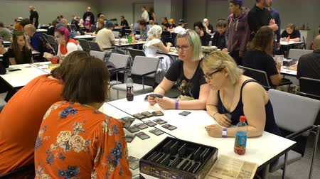 dungeons and dragons : HELSINKI, FINLAND - JULY 29, 2017: A group of friends play tabletop games. Exhibition ROPECON is show tabletop, live-action and card role-playing games, miniature war and board games. Stock Footage