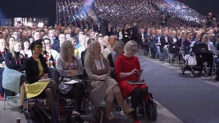 conference centre : HELSINKI, FINLAND - OCTOBER 02, 2017: Huge audience listens to the speaker. Nordic Business Forum - annual business conference in Helsinki gathers together over 6000 attendees from over 30 countries. Stock Footage