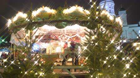 senate square : HELSINKI, FINLAND - DECEMBER 16, 2016: Children merry-go-round at Christmas market on Senat Square, Helsinki.