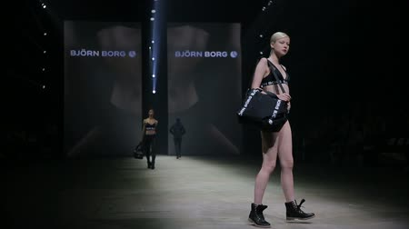 pist : HELSINKI, FINLAND - OCTOBER 20, 2017: Fashion Show sports wear and underwear Bjorn Borg during Fair I LOVE ME - Beauty, Health, Naturally, Fashion and Jewel Watch at Messukeskus Expo Centre Stok Video