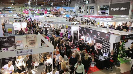 alışveriş : HELSINKI, FINLAND - OCTOBER 20, 2017: A lot of women testing and buying cosmetics during fair I LOVE ME - Beauty, Health, Naturally, Fashion and Jewel Watch at Messukeskus Expo Centre