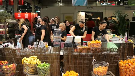 alışveriş : HELSINKI, FINLAND - OCT 20, 2017: Young women working at juice bar and cutting fruits. Female bartenders making fresh juice. Fair I LOVE ME - Beauty, Health, Naturally, Fashion at Messukeskus Expo Centre