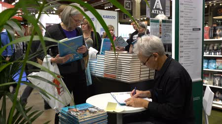 bookshop : HELSINKI, FINLAND - OCTOBER 29, 2017: Autograph session Mauri Tapio Kunnas. The world-famous Finnish writer, author of comic books and illustrated books for children. A huge book fair at the Expocentre Messukeskus.