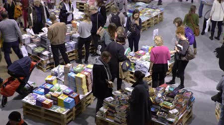 bookshop : HELSINKI, FINLAND - OCTOBER 29, 2017: Many lovers of reading, buyers, publishers and books at the big book fair. A huge book fair at the Expocentre Messukeskus.