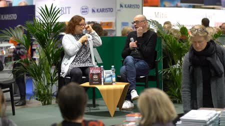 bookshop : HELSINKI, FINLAND - OCTOBER 29, 2017: Presentation of a new book by Norwegian writer Samuel Bjork. A huge book fair at the Expocentre Messukeskus. Stock Footage