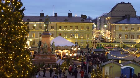 senate square : HELSINKI, FINLAND - DECEMBER 11, 2017: Traditional holiday market with Christmas Tree, decorations and childrens rides on Senate Square opposite the Cathedral.