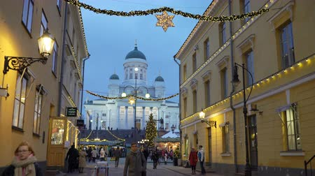 senate square : HELSINKI, FINLAND - DECEMBER 11, 2017: Streets in Helsinki city centre with Christmas decorations close to the Senate square