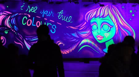 luxo : HELSINKI, FINLAND - MAY 07, 2018: Fluorescent graffiti on the wall during the public Festival of Light LUX.