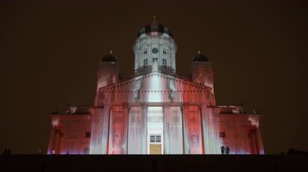 luxo : HELSINKI, FINLAND - JAN 07, 2018: Dinamic Light Installation on the Facade of the Cathedral of Helsinki during the public Festival of Light LUX. Time Lapse