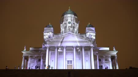 luxo : HELSINKI, FINLAND - JAN 07, 2018: Dinamic Light Installation on the Facade of the Cathedral of Helsinki during the public Festival of Light LUX. Stock Footage