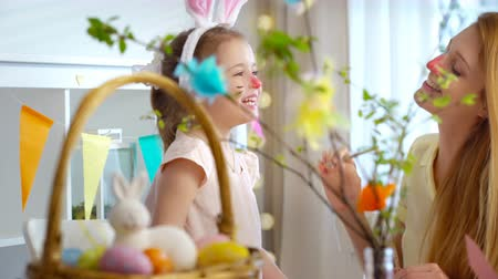 koszyk wielkanocny : Happy Easter! A young mother and her little daughter having fun and paint each others Bunnies faces Wideo