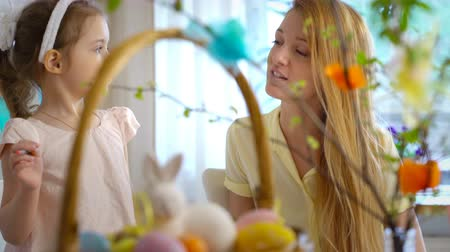 rabbit ears : Happy Easter! A young mother and her little daughter having fun and paint each others Bunnies faces Stock Footage