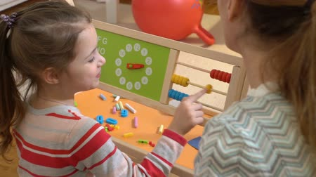 aritmética : Early childhood development. Little girl doing math exercises with her mother at home. Slow motion Stock Footage
