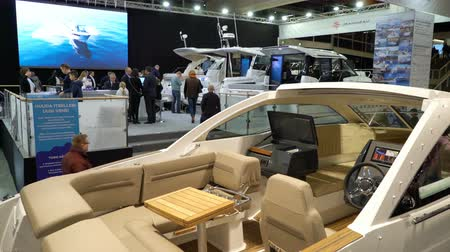 mariner : HELSINKI, FINLAND - FEB 15, 2018: Helsinki International Boat Show 2018. Visitors inspect boats of different models and prices. Northern Europes largest boating event to boaters, water sports enthusiasts and fishermen