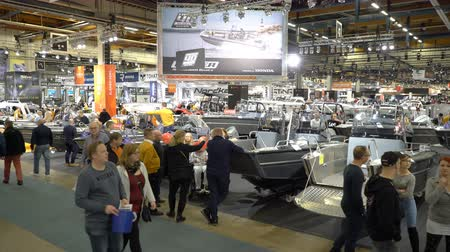 mariner : HELSINKI, FINLAND - FEB 15, 2018: Helsinki International Boat Show 2018. Visitors inspect boats of different models and sizes. Northern Europes largest boating event to boaters, water sports enthusiasts and fishermen