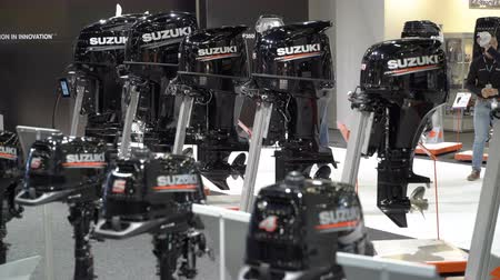 mariner : HELSINKI, FINLAND - FEB 15, 2018: Powerful boat motors Suzuki. Helsinki International Boat Show 2018. Northern Europes largest boating event to boaters, water sports enthusiasts and fishermen Stock Footage