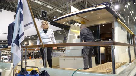 mariner : HELSINKI, FINLAND - FEB 15, 2018: Visitors inspect boats of different models and prices. Helsinki International Boat Show 2018. Northern Europes largest boating event to boaters, water sports enthusiasts and fishermen