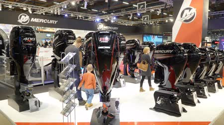 mariner : HELSINKI, FINLAND - FEB 15, 2018: Powerful expensive boat motors Mercury. Helsinki International Boat Show 2018. Northern Europes largest boating event to boaters, water sports enthusiasts and fishermen Stock Footage