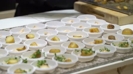 trade show : The chefs prepare food samples and treat visitors during the Food Show Stock Footage