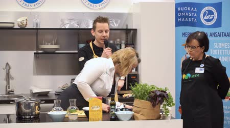 trade fair : HELSINKI, FINLAND - MARCH 18,2018: Chef presents a new eco-friendly products by well-known manufacturers during the Show Gastro Helsinki - big trade fair for the hotel, restaurant and catering industry Stock Footage