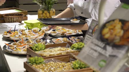 trade fair : HELSINKI, FINLAND - MARCH 18,2018: The chefs prepare food samples and treat visitors during the Show Gastro Helsinki - big trade fair for the hotel, restaurant and catering industry