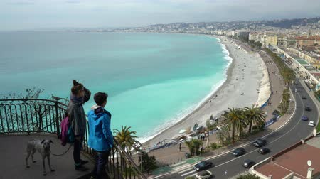 cote : NICE, FRANCE - MARCH 28, 2018: Tourists enjoy views of the Bay of Angels (Baie-des-Anges), Provence, Cote dazur, France