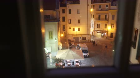 wrecker : SANREMO, ITALY - MARCH 29, 2018: A night incident in the city. Ambulance car on the street. The view from the window. First aid, life insurance, terrorist threat