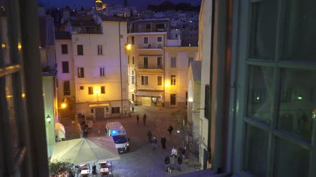 first officer : SANREMO, ITALY - MARCH 29, 2018: A night incident in the city. Ambulance car on the street. The view from the window. First aid, life insurance, terrorist threat