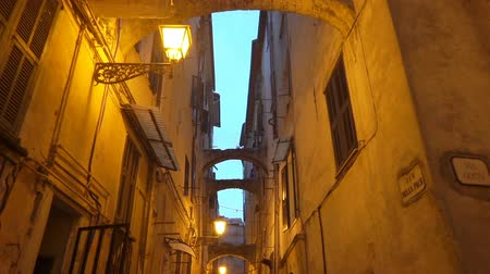 dekarz : A narrow pedestrian street in the old town of Sanremo late at night. Imperia province, Liguria region, Italy