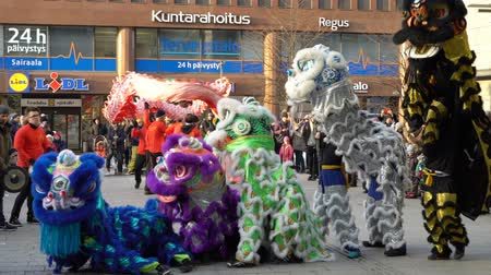 lion : HELSINKI, FINLAND - FEBRUARY 15, 2018: Chinese New Year parade show. Traditional Chinese new year dragons on the streets of Helsinki.