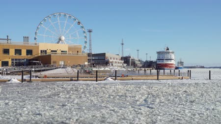 boldness : HELSINKI, FINLAND - FEBRUARY 24, 2018: Allas Sea Pool in the center of Helsinki in winter. Sauna and a saltwater pool open all year round.