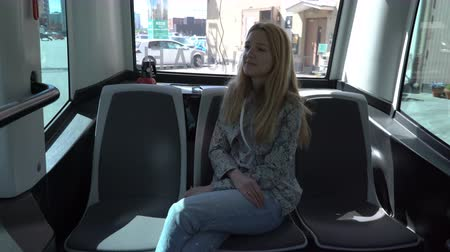algılayıcı : HELSINKI, FINLAND - MAY 25, 2018: Young woman in automated remotely operated bus in Helsinki. Unmanned public transport on street.