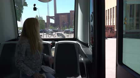 érzékelő : HELSINKI, FINLAND - MAY 25, 2018: Young woman in automated remotely operated bus in Helsinki. Unmanned public transport on street.