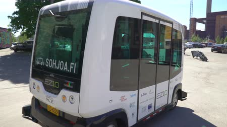 self driving : HELSINKI, FINLAND - MAY 25, 2018: Automated remotely operated bus in Helsinki. Unmanned public transport on street. Stock Footage