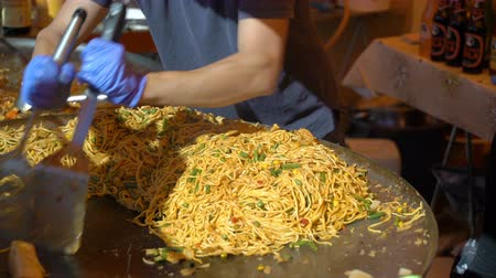 market vendor : Street vendors prepare fast Asian noodles on the street in Helsinki.