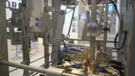 senzor : HELSINKI, FINLAND - MAY 30, 2018: The robotic packaging systems of the Finnish company Orfer during the big exhibition PacTec. Orfer Oy innovates, engineers and manufactures robotized material handling systems for various industries sectors.