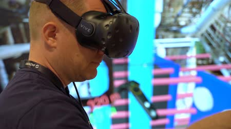 wizualizacja : HELSINKI, FINLAND - MAY 30, 2018: Engineer are using virtual AR to simulate industrial space, repair and design various technological designs. Industry 4.0 concept by finnish company Poyry during the exhibition PacTec in Helsinki