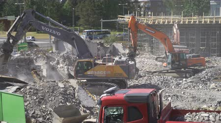 earthworks : ESPOO, FINLAND - JUNE 04, 2018: Heavy construction machinery working on the construction of a new residential area.