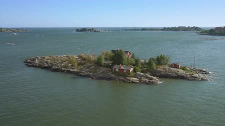 fince : Aerial view footage of Helsinki bay. Small house on a lonely island near Helsinki, Finland